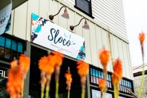 Flowers and Sign in front of Sloco